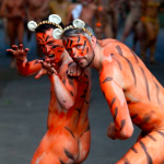 Why Are These Naked Guys Painted Like Tigers?